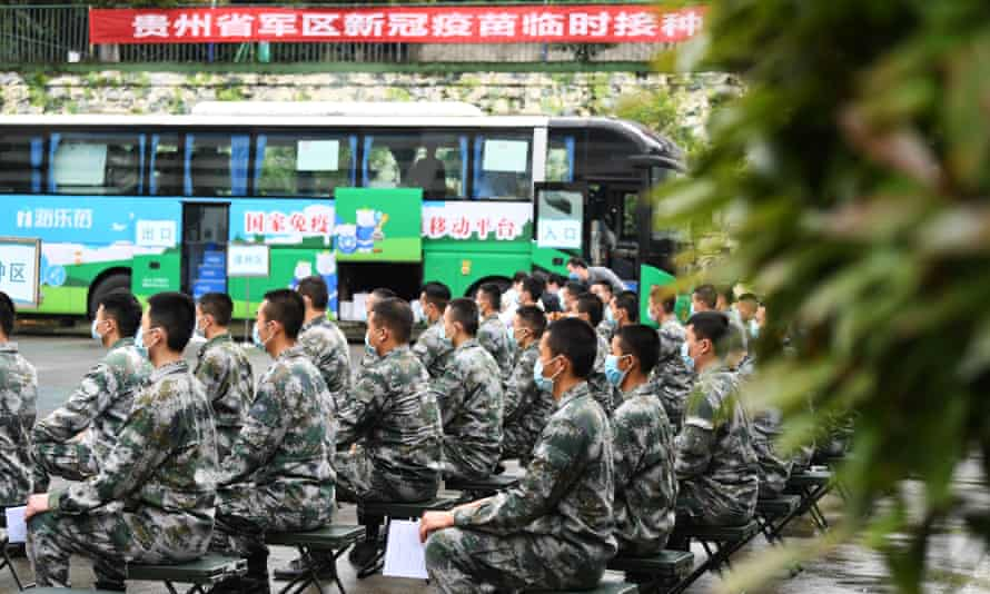 Soldiers are waiting to receive a vaccine in Guiyang, southwest China.
