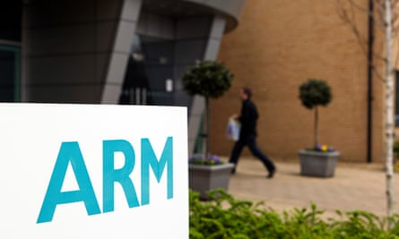 An employee enters the ARM Holdings Plc headquarters in Cambridge.