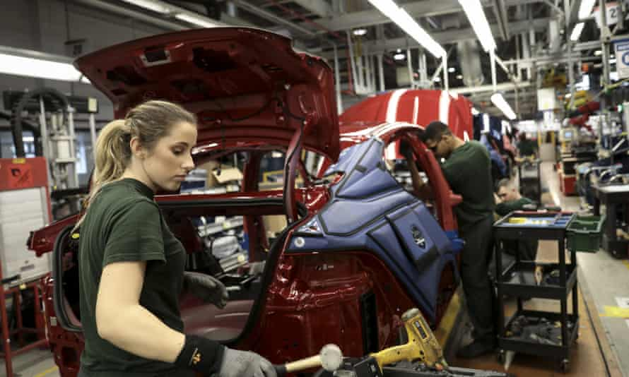 Workers assemble vehicles at Jaguar Land Rover's Castle Bromwich factory. The plant was at the brink of closure in 2010.