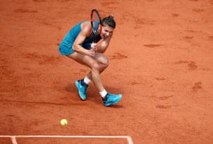Simona Halep scurries to the corner of the court to play a return.