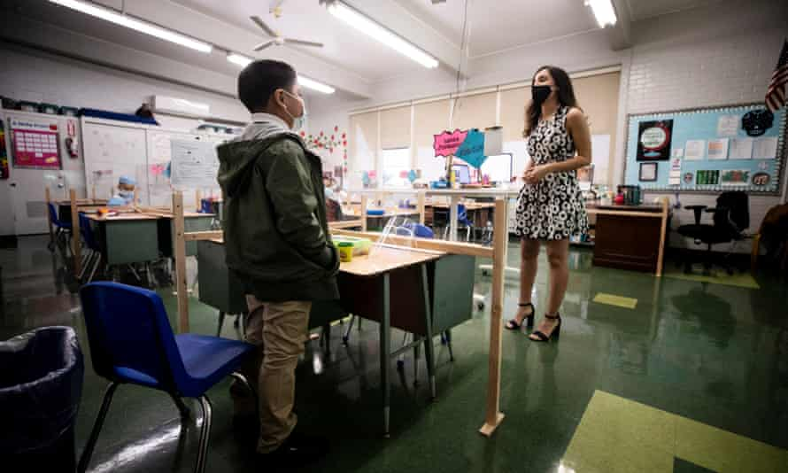 A student attends class at Resurrection Catholic school in east Los Angeles on its first day of reopening amid the pandemic.