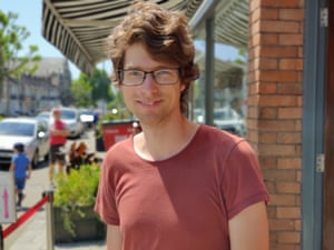 Tom Adams, a young man in a red T-shirt, who lives in Bristol's northern suburbs
