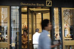 People walk past Deutsche Bank's Manhattan headquarters today