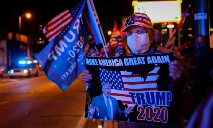 Supporters of Donald Trump rally in front of Cuban restaurant Versailles in Miami, Florida.