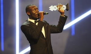 Stormzy accepts his award for Best Grime Act during the Mobo awards 2015.