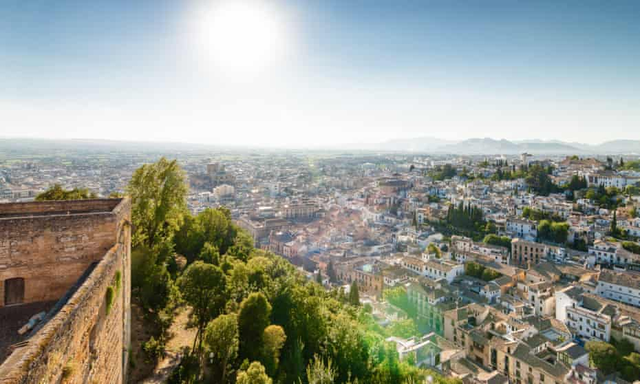 Sunny view of Granada from viewpoint of garden of Generalife, Andalusia province, Spain.