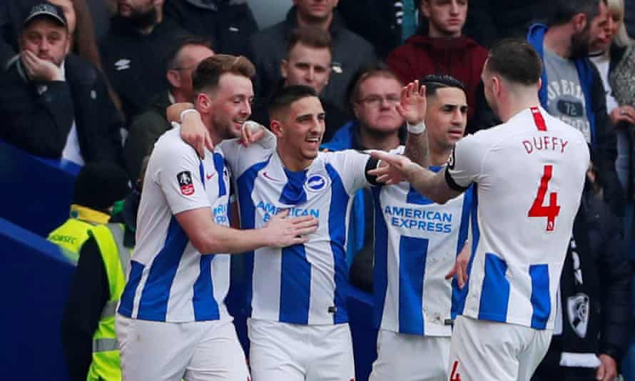 Brighton's Anthony Knockaert celebrates with teammates after scoring their first goal.