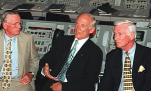 Gene Cernan, right, with Neil Armstrong , left, and Buzz Aldrin, answering media questions in 1999.