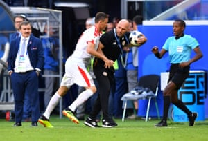Nemanja Matic clashes with Costa Rica's assistant coach Luis Marin.