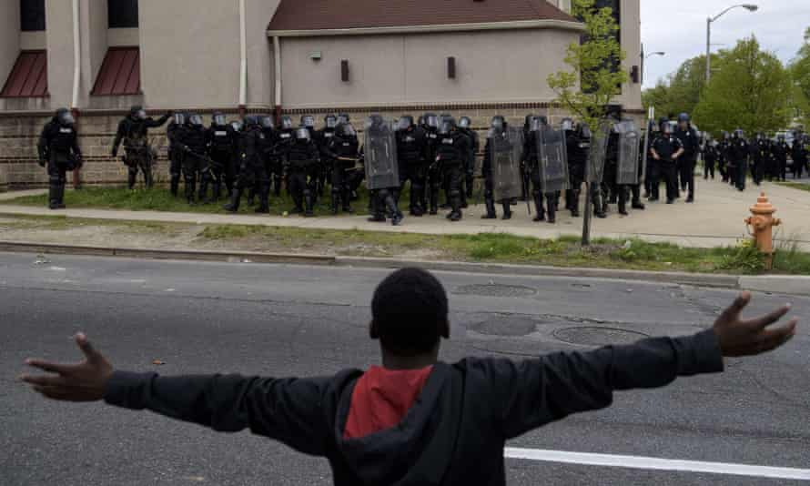 freddie gray protestors arms out