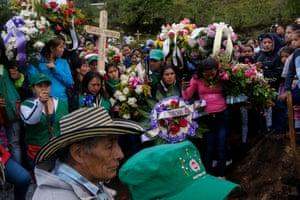 Community members and the Indigenous Guard of the Kokonuko people bury Efigenia Vasquez in Coconuco
