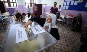 A voter casts her ballot at a polling station in Trabzon, Turkey.
