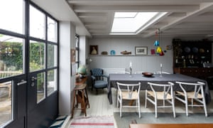 Room with a view: dining table and doors to the garden.