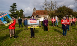 A protest in front of the 850-year-old St Mary's church in Binsted
