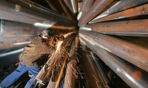 An engineer works on a steel sculpture in Sheffield.
