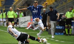 Timothy Castagne tries to burst past Parma's Juraj Kucka in a Serie A game in July.