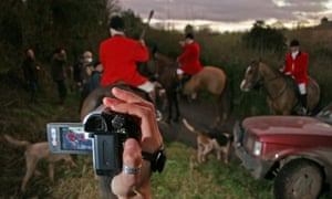 The South Herefordshire Hunt being filmed by a hunt saboteur, Herefordshire, UK