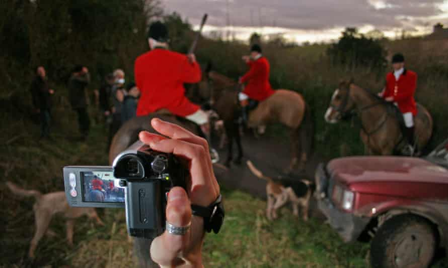 The South Herefordshire Hunt being filmed by a hunt saboteur, Herefordshire, UK
