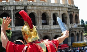 A man dressed as a Roman centurion at the Colosseum in Rome.