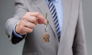 Man holding out house keys