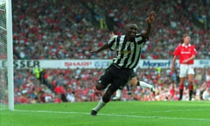 Andy Cole celebrates after scoring against Manchester United in August 1993. 'I really struggled to embrace the adulation because that's not my bag,' he says of his time at Newcastle United.