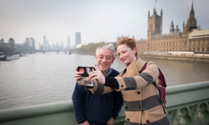 A woman takes a selfie with John Bercow on Westminster Bridge in London.
