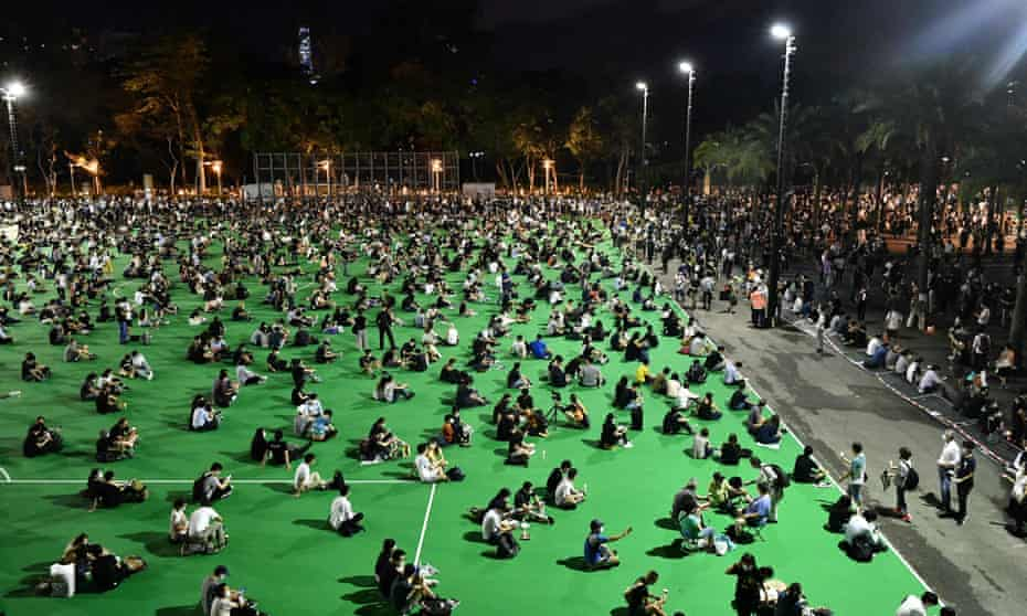 Activists gathered in Hong Kong's Victoria Park in June to mark the Tiananmen anniversary. Twenty-five have been charged with taking part in a banned event.