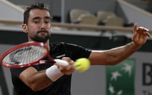 Marin Cilic of Croatia struggles against Dominic Thiem of Austria.