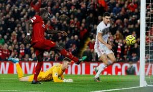 Liverpool's Sadio Mane rams the ball into the empty net!