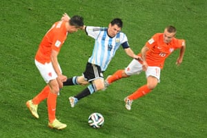 Holland's Robin van Persie and Wesley Sneijder chase Argentina's Lionel Messi