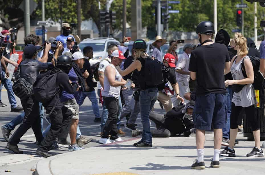 Anti-vaccine protesters clash with counter protesters during a protest in front of city hall in Los Angeles on 14 August.