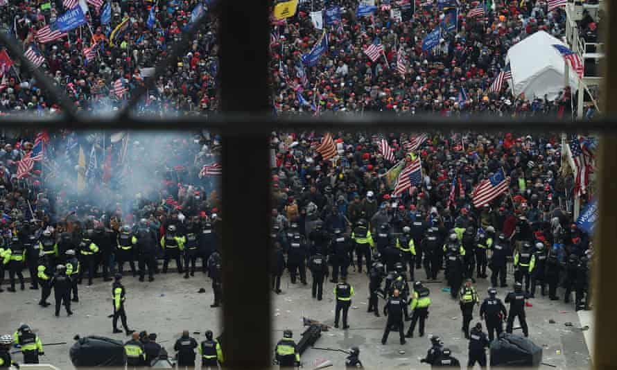 Police hold back a mob of Trump supporters outside the US Capitol's Rotunda on 6 January. Almost 600 people have been criminally charged for their part in the events.