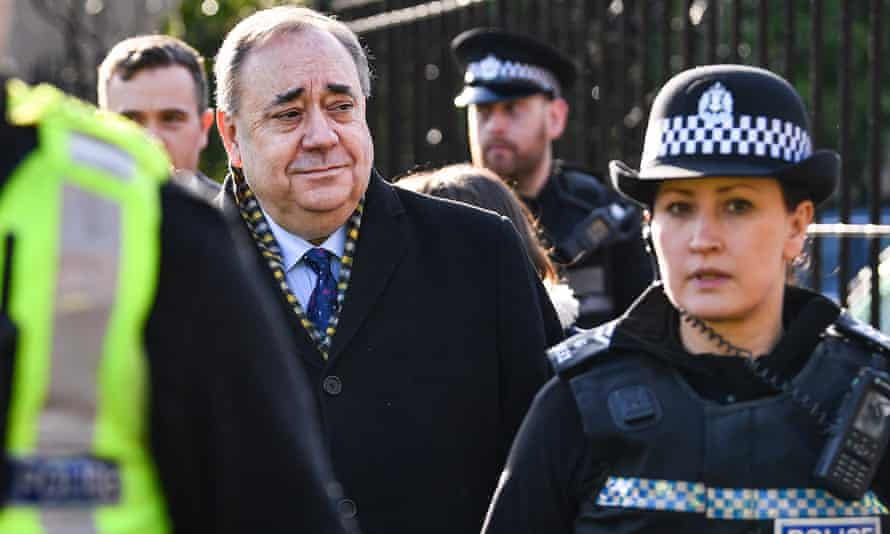 Alex Salmond surrounded by police