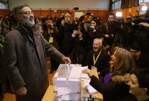 Carles Riera, the leader of Catalonia's leftwing pro-independence CUP party, casts his ballot at a polling station in Barcelona