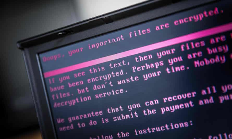 A laptop screen displays a message after a ransomware attack