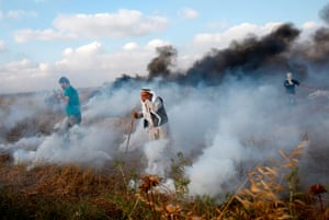 GazaPalestinian demonstrators react to teargas fired by Israeli troops during a protest at the Israel-Gaza border.