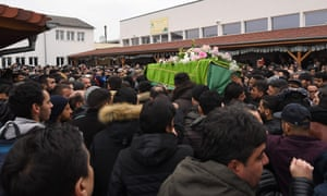 People carry the coffin of Kamal Naghchband, who was killed in the Strasbourg attack.