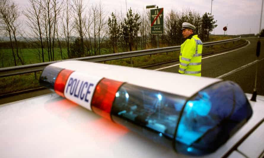 Transport police officer directing motorway traffic