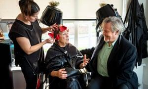 Giles Watling, MP for Clacton, speaks to customer Carol Kincaid in a hair salon