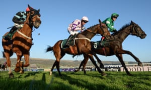 Flying Tiger, right, with Richard Johnson up, beats Divin Bere, centre, with Noel Fehily up, who finished second, and Nietzsche, with Danny Cook up, who finished third, to win the Fred Winter Juvenile Handicap Hurdle.