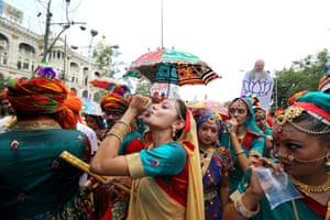 Kolkata, India Bharatiya Janata party activists and dancers pause for refreshments during a rally