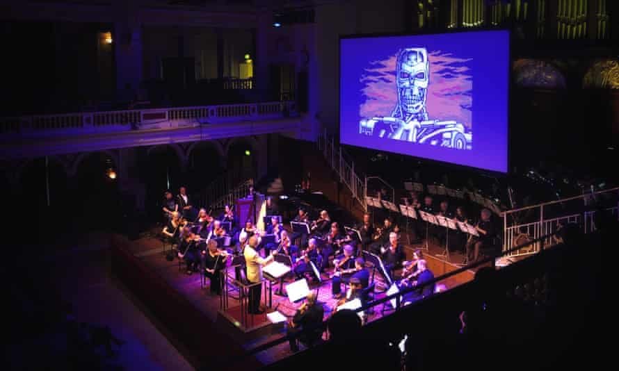 Game on … imagery from 1980s Commodore 64 games plays on a screen behind the orchestra.