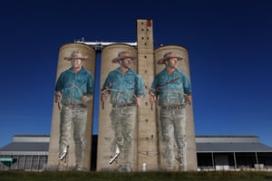 With sticks in his hand, a water diviner searches for groundwater in this mural, painted by Fintan Magee at Barraba in New South Wales. Diviners study the land and as they walk minerals and magnetic forces supposedly move the sticks when there is moisture below. Despite studies saying the technique is pseudoscience, diviners are still used in Australia to find groundwater.