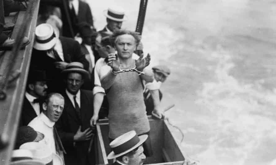 Harry Houdini performs a trick in New York's East River.