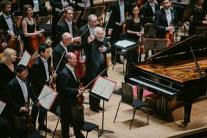 The pianist Radu Lupu, centre, with conductor Paavo Järvi and the Philharmonia at the Royal Festival Hall.