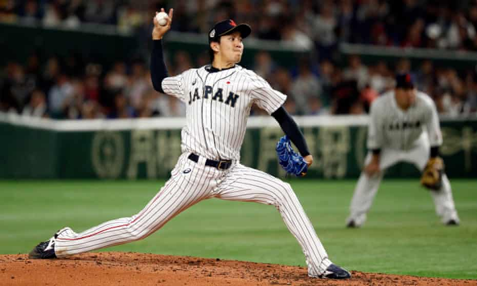 Takayuki Kishi throws a pitch for Japan against an MLB All-Stars side in 2018.