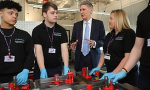 Philip Hammond, the chancellor, talking to staff and students at the Advanced Engineering Centre at Dudley College this morning.