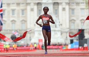 Brigid Kosgei of Kenya crosses the line to win the women's elite race