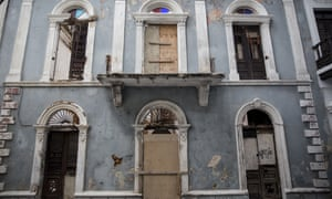 A damaged building stands in Old San Juan as Puerto Rico residents prepare for a direct hit from Hurricane Maria.