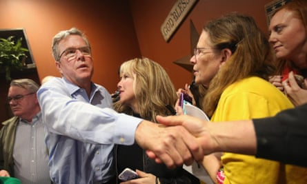 Former Florida governor Jeb Bush greets Iowa residents at a Pizza Ranch restaurant in Cedar Rapids.